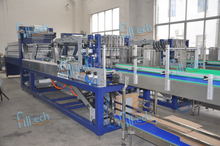Half-tray shrink wrapping machine